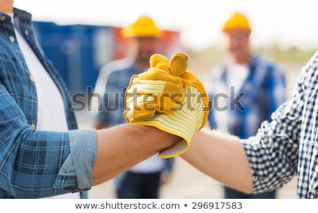 manual workers greeting each other stock photo © photography33