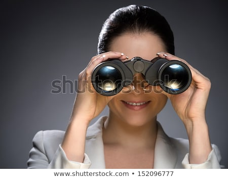 Portrait of a happy businesswoman looking through binoculars against a white background Stock photo © wavebreak_media
