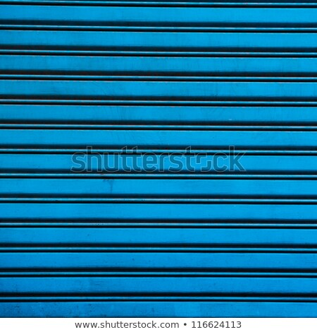 blue painted galvanised steel roller shutter background stock photo © snapshot
