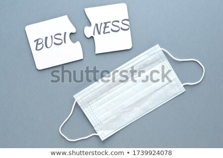 Debt - White Word on Blue Puzzles. Stock photo © tashatuvango