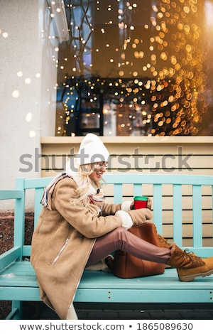 beautiful woman in mittens with backpack stock photo © dolgachov