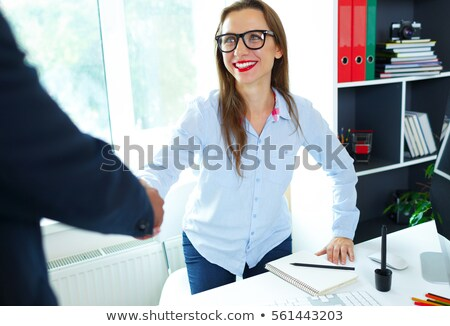 Modern business woman with arm extended to handshake Stock photo © vlad_star