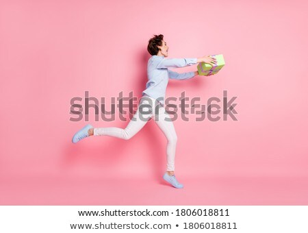 Full length of happy charming young woman with present  Stock photo © deandrobot