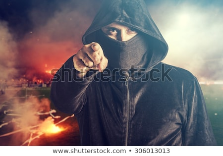 Unrecognizable hooded soccer hooligan portrait Stock photo © stevanovicigor