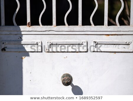 People running in front of the gated building Stock photo © bluering