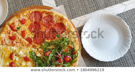 diferent pizza parts on table table top view stock photo © adamr