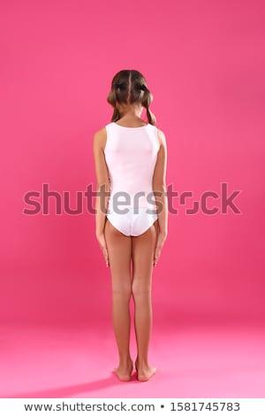 Girl in underwear standing back Stock photo © deandrobot