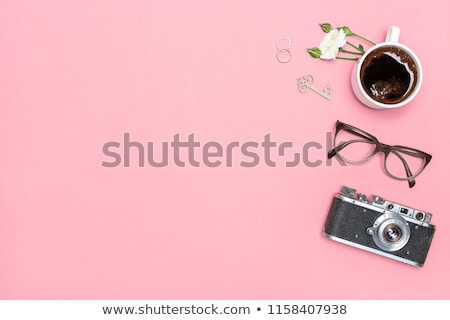 camera with photographs on desk stock photo © wavebreak_media