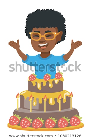 Little african boy jumping out of a large cake. Stock photo © RAStudio