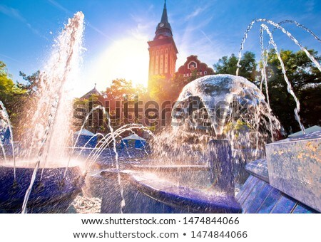 Subotica city hall and fountain sun haze view Stock photo © xbrchx