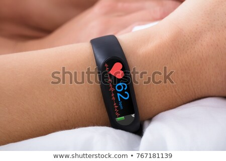 Stock photo: Close up hand with smartwatch and numbers