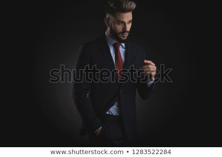 relaxed businessman looks down to side with mouth open stock photo © feedough