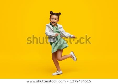 adorável · pequeno · criança · posando · sorridente · bastante - foto stock © studiolucky