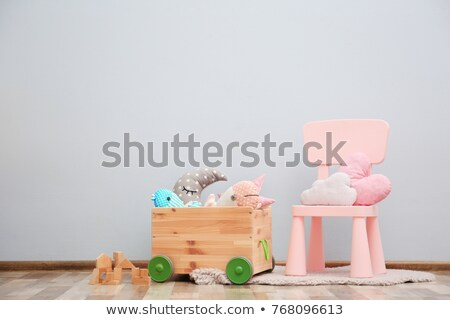 Baby girl and many toys in bedroom stock photo © colematt