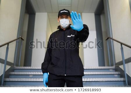 Guardia de seguridad cara máscara parada gesto Foto stock © AndreyPopov