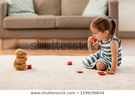 girls playing with toy crockery and teddy at home Stock photo © dolgachov