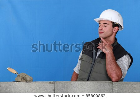 Bricklayer contemplating his trowel Stock photo © photography33