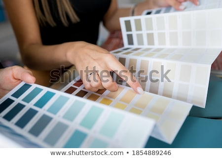 Woman holding up paint colour samples Stock photo © photography33