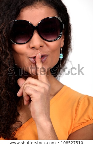 Stock photo: Mixed Race Woman With Sunglasses Asking For Silence