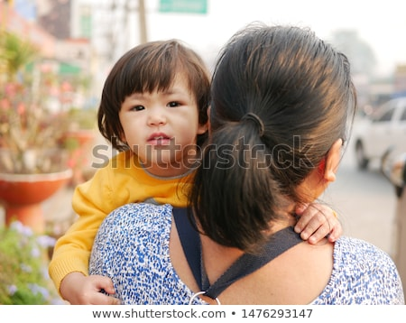 Young mother taking care of her adorable baby Stock photo © wavebreak_media