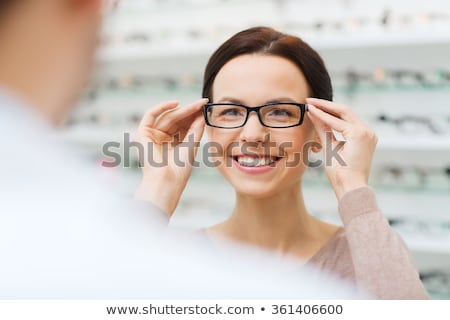 Putting Eye Glasses On Stock photo © AlphaBaby