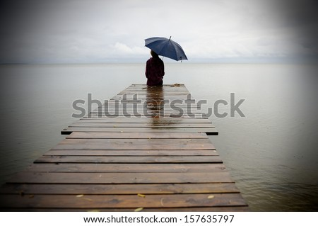 Edge of pier with woman in water Stock photo © ElinaManninen