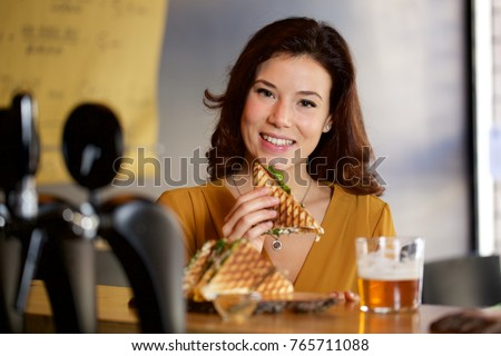 beautiful waitress with a tray with beers and sandwiches stock photo © jackybrown