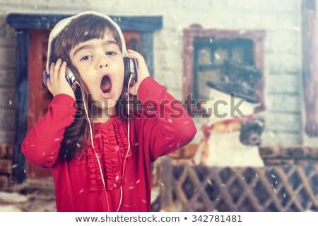 Stock photo: Happy young girl singing Christmas carols