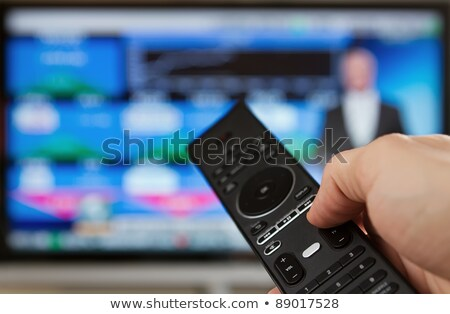 Businessman holding a tv remote Stock photo © wavebreak_media