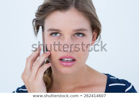 Unsmiling woman calling with her smartphone  Stock photo © wavebreak_media