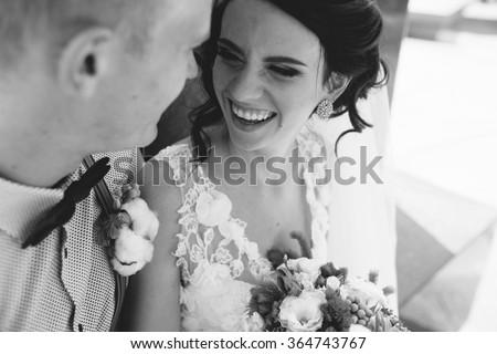 Сток-фото: Wedding Couple Sitting On A Stone Bench