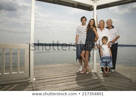 Portrait of happy grandfather and grandson leaning on railing Stock photo © wavebreak_media
