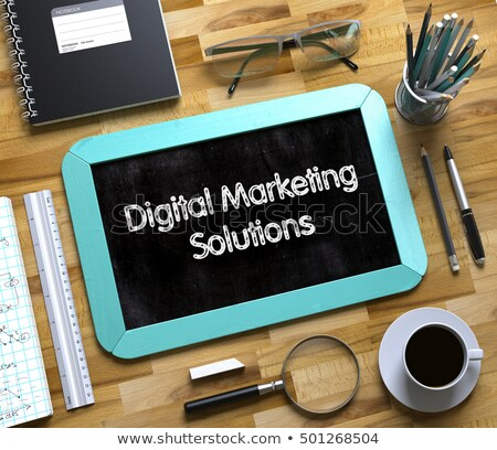 digital marketing solutions on small chalkboard 3d stock photo © tashatuvango