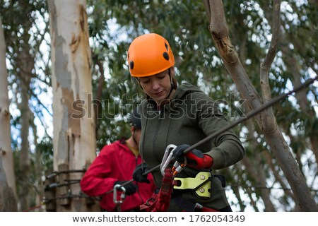 Hiker couple holding zip line cable in the forest Stock photo © wavebreak_media