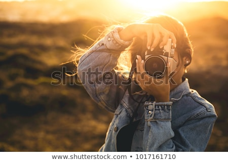 Woman taking a picture Stock photo © IS2