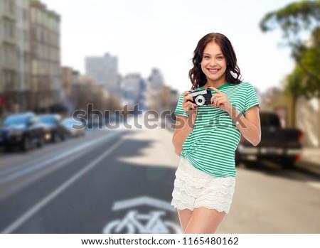 teenage girl with camera over san francisco city Stock photo © dolgachov