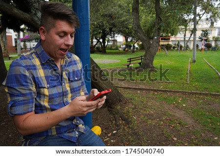 seated concerned man holding a mobile phone in his hand Stock photo © feedough