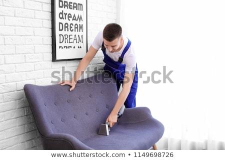 Сток-фото: человека · очистки · диван · пылесос · фото · человек