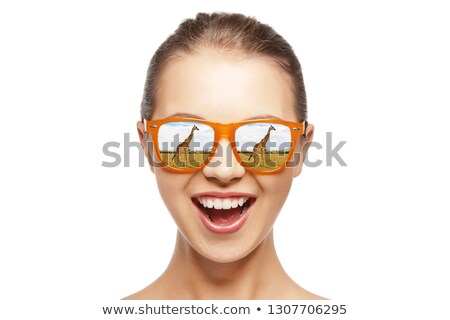 happy teen girl in sunglasses looking at giraffes Stock photo © dolgachov