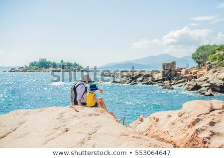 Man traveler at the Hon Chong cape, Garden stone, popular tourist destinations at Nha Trang. Vietnam Stock photo © galitskaya