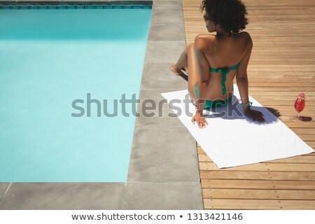 Jovem africano americano mulher relaxante quintal Foto stock © wavebreak_media