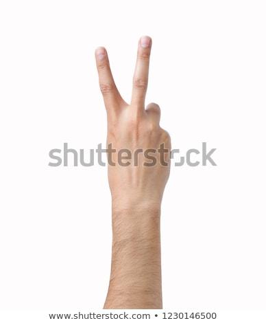 Fiatalember mutat kettő ujjak béke kézjel Stock fotó © dolgachov
