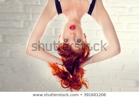 Studio Portrait Of Young Girl upside down Stock photo © Lopolo
