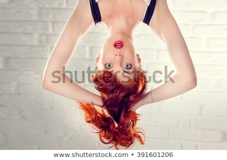 Studio portret jong meisje ondersteboven glimlach gelukkig Stockfoto © Lopolo
