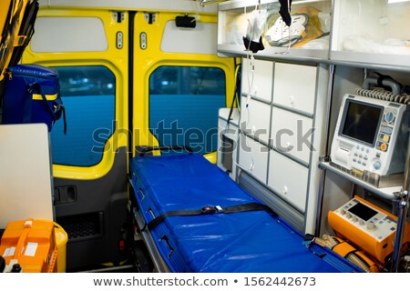 Interior of contemporary ambulance car with stretcher and medical equipment Stock photo © pressmaster