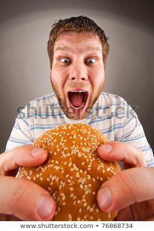 Man eating juicy hamburger Stock photo © nomadsoul1