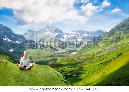 Mulher sessão montanha meditação céu feliz Foto stock © AndreyPopov
