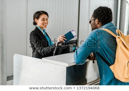 Afrikaanse vrouw paspoort lucht ticket reizen Stockfoto © dolgachov
