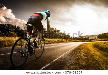Estrada bicicleta ciclista homem ciclismo pôr do sol Foto stock © Maridav