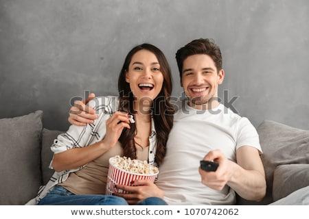 Portrait heureux couple regarder tv Photo stock © deandrobot